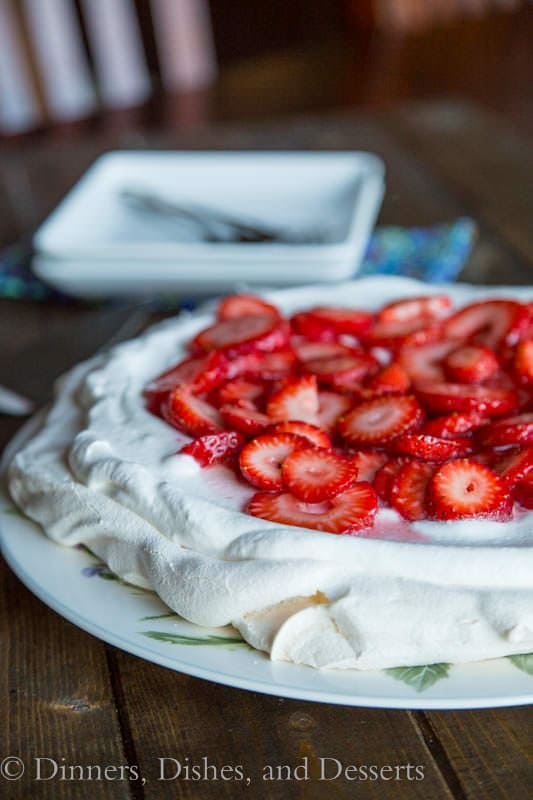 Strawberry Pavlova on a plate with green leaves
