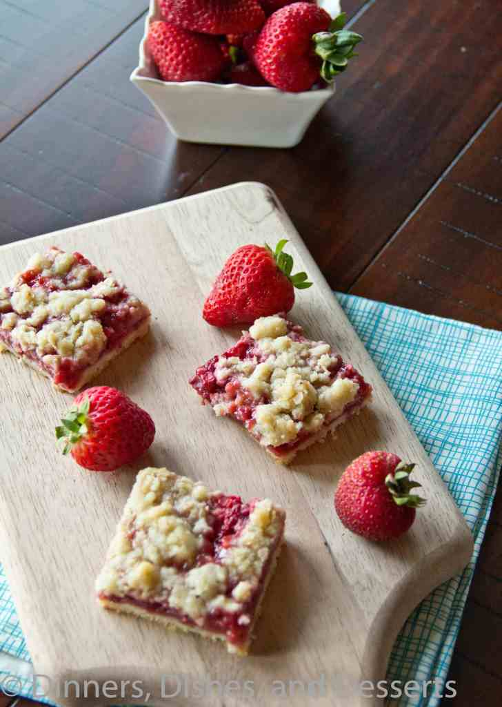 Strawberry Crumb Bars on a cutting board