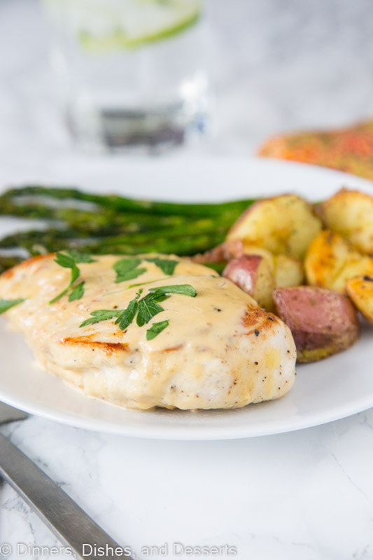 Chicken in a French Pan Sauce - juicy chicken breasts cooked until golden brown and topped a tangy and delicious pan sauce.  Chicken pan sauce sounds fancy, but is ready in minutes!