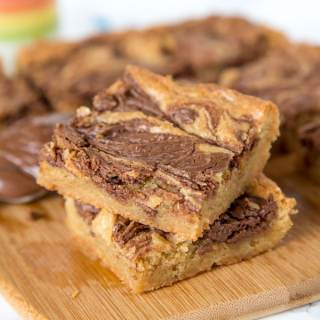 Nutella Swirl Blondies - Quick and easy blondies made in one bowl with a swirl of Nutella. All that buttery and brown sugar taste you love with an extra touch of chocolate.