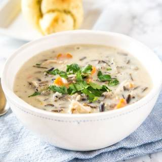 A bowl of soup, with Cream and wild rice