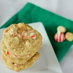 Hershey's Peppermint Macadamia Nut Oatmeal Cookies stacked on white plate with green napkin