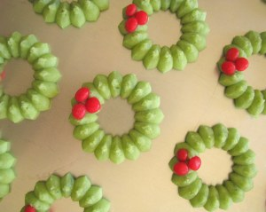 Holly Wreaths cookies on baking sheet