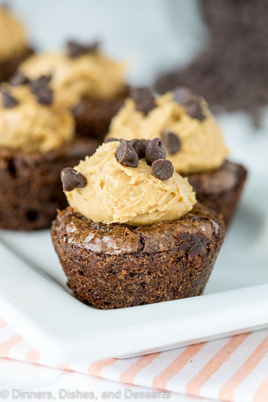 A close up of brownies topped with peanut butter and chocolate chips