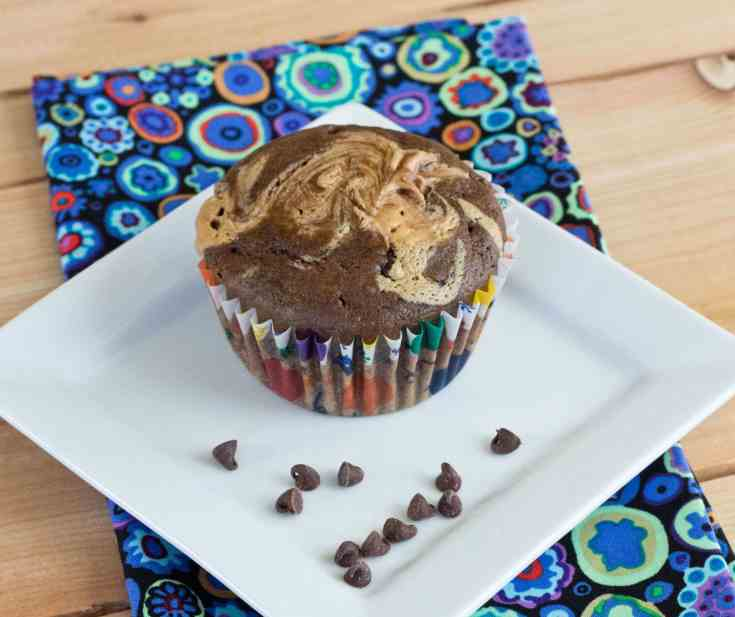 Double Chocolate Peanut Butter Swirl Muffins - Soft and tender Double Chocolate Muffins, with a swirl of peanut butter on top!