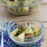 Lemon-Herb Potato Salad in glass bowl with fork