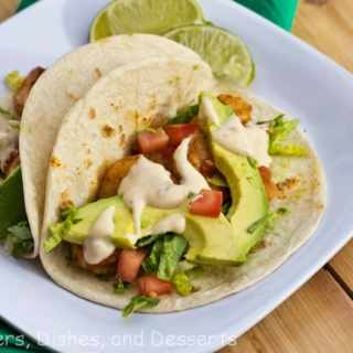 Baja Shrimp Tacos - a fun twist on taco night based on Red Robin's recipe. Slightly spice shrimp with a chipotle lime sauce!