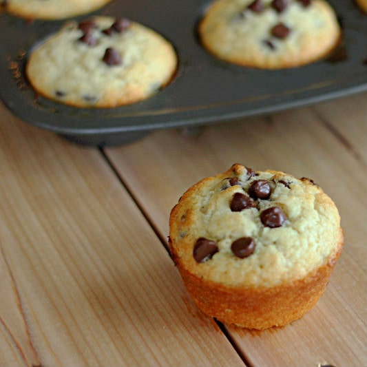 Chocolate Chip Muffins - Light and fluffy muffins with lots of chocolate chips. Great to make and stash in the freezer for quick mornings.