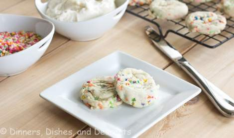 Funfetti Sandwich Cookies - Made from scratch funfetti cookies sandwiched with buttercream frosting. Because sprinkles just make everything more fun!