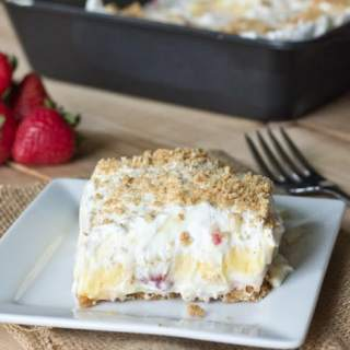Strawberry Cream Squares - light and creamy layers with fresh strawberries and a graham cracker crust. Easy and delicious no bake dessert!