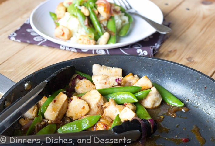 sweet and spicy chicken stir fry on a plate