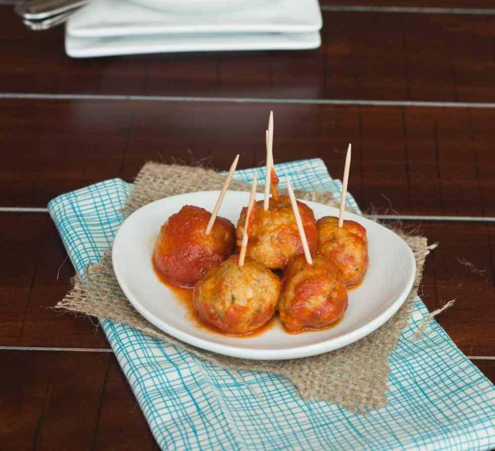 italian chicken meatballs on a plate