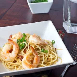 Speedy Shrimp Pasta - Plump and juicy shrimp sauteed in olive oil, garlic, and onions. Tossed with pasta for a quick and easy dinner.