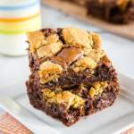 Brookies - These brownie cookie bars have a fudgy brownie on the bottom and topped with chocolate chip cookies.  No need to pick between two favorite ever again!