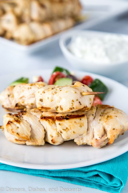 Greek chicken skewers with tzatziki sauce and greek salad