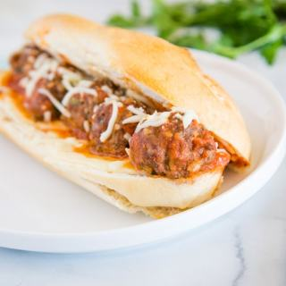 A close up of food on a plate, with Meatball Sub