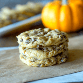 chewy pumpkin chocolate chip cookies on a board