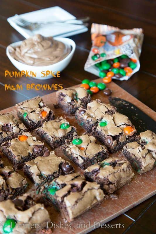 pumpkin spiced m&m brownies on a plate