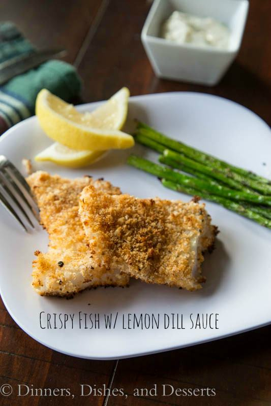 crispy fish with lemon dill sauce on a plate