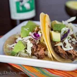 slow cooker chipotle beef tacos on a plate