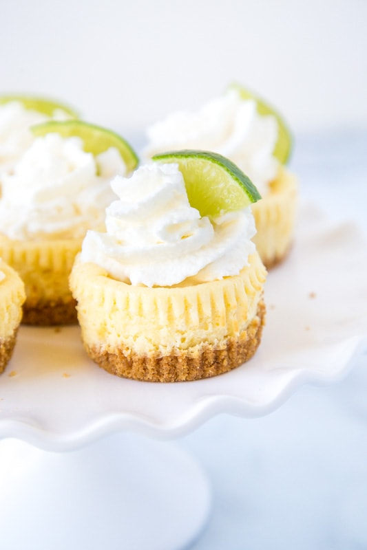 A piece of cake  on a plate, with Cheesecake and Lime