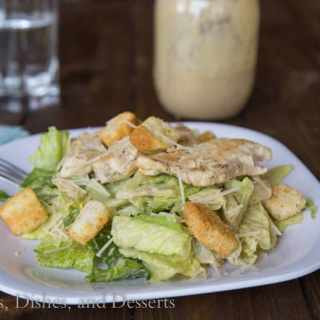 Chicken Caesar Salad - lighten up your average Caesar salad by using Greek yogurt!  Add chicken and you have a great meal that will get your family excited about salads!