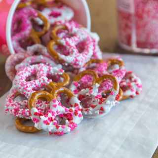 Chocolate Covered Pretzels - super easy and fun treat for any occasion. A sweet and salt treat that you can make in minutes and decorate for any holiday. Pretzels dipping in white chocolate and coated in sprinkles.