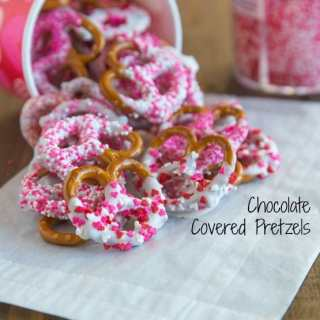 Chocolate Covered Pretzels - super easy and fun treat for any occasion. Pretzels dipping in white chocolate and coated in sprinkles.