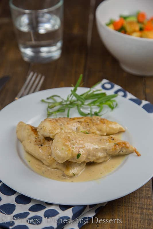 Chicken with Tarragon –Mustard Sauce is a creamy, tangy sauce that comes together in minutes.  Turn plain old chicken into something special even on a busy weeknight.  My kitchen has kind of turned into a disaster zone lately.  It all started when our freezer started leaking water (inside the freezer), and coating the whole thing in ice. To replace it meant having to remodel a portion of our kitchen.  The fridge that came with the house was a custom, built-in fridge.  FYI – those are extra wide!  You can't just replace them with a normal size fridge, because you end up with a 6 inch gap between the fridge and the cabinet next to it.  Not to mention the giant gap above it, because they are also extra tall.  So yeah, fun times at my house!   Considering the disaster zone that is my kitchen right now, I have to figure out how to cook dinner without an oven and in a small usable space.  This chicken with tarragon-mustard sauce is perfect.   Everything is made in just one pan, and ready in less than 20 minutes.  I used chicken tenders because that is what I had on hand, but cutlets would be done even faster.  The tarragon-mustard sauce is creamy and just a little tangy from the mustard.  The tarragon gives a hint of licorice flavor, but definitely not over powering.   Everyone at my house pretty much licked their plates clean, they loved the sauce so much.  You could even serve over egg noodles to soak up all that goodness.  I served mine with a giant salad but pan charred asparagus or cheesy garlic pull apart bread would be really good as well.  My husband thought the leftovers were great the next day for lunch too.  Definitely a great quick and easy weeknight meal that turns ordinary chicken into something special.