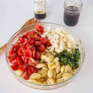 Caprese Pasta Salad - turn classic caprese salad into a quick pasta salad. Great for summer get togethers, quick lunches, or a light dinner!