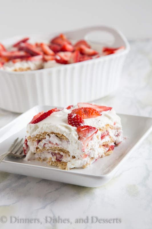 Strawberry Ice Box Cake - no bake cake that is perfect for summer. Layers of fresh whipped cream, strawberries, and graham crackers. It will disappear quickly!