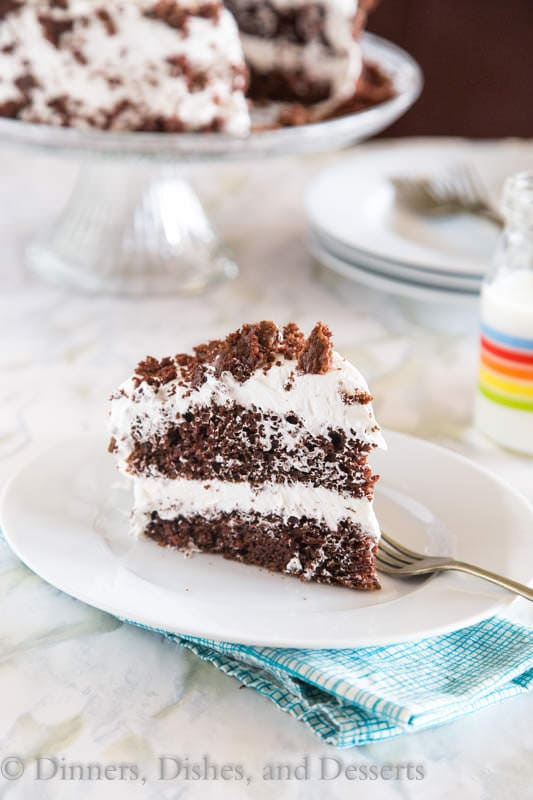 """Chocolate Cream Cake - Moist chocolate cake topped with a light and fluffy almond flavored whipped cream """"frosting""""."""