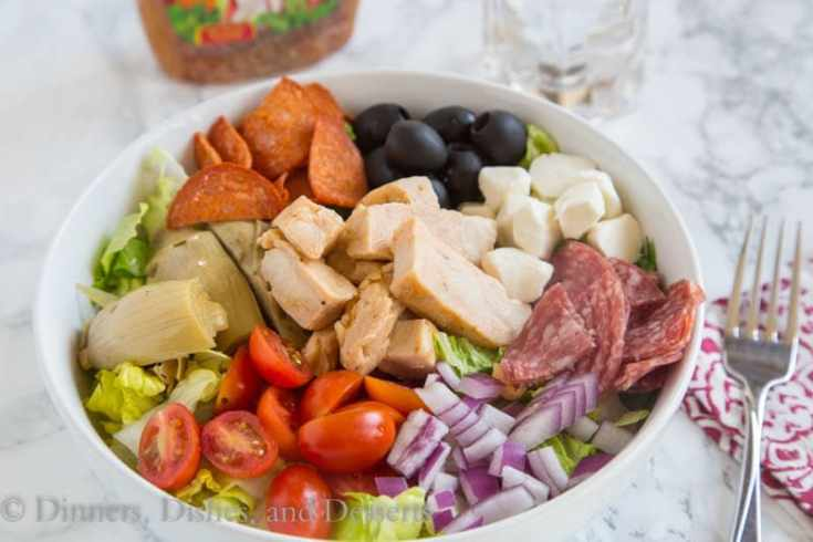 grilled chicken antipasto salad in a bowl