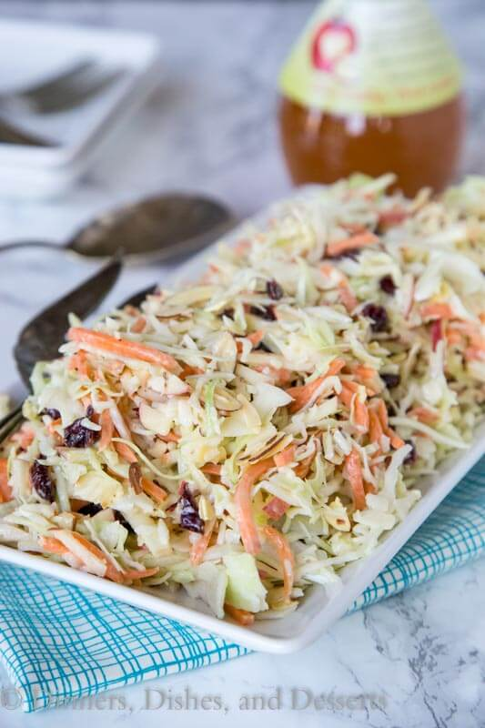 Cranberry Apple Coleslaw - an easy coleslaw recipe that you can make ahead of time, and bring to any summer get together. Or serve at home with just about anything!