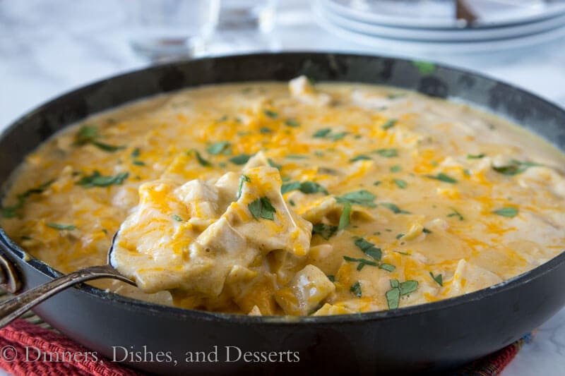 white chicken enchilada skillet in the pan