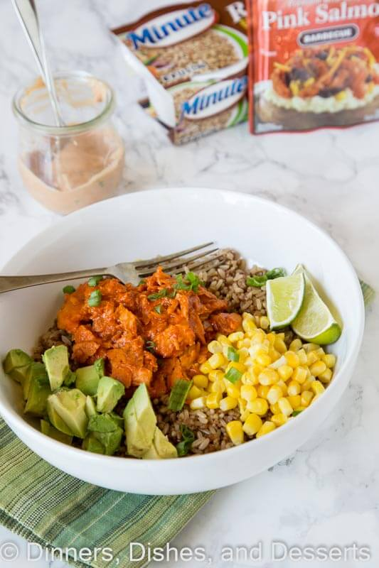 Barbecue Salmon Bowls - Ready in 10 minutes and so easy!! Barbecue salmon over rice with corn, avocado, and a yummy sauce.