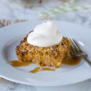 Pumpkin Dump Cake - a super easy, 6 ingredient cake that you can put together in minutes. Top with whipped cream and caramel for an amazing fall treat!
