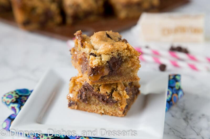 Chocolate Chip Caramel Cookie Bars - classic chocolate chip cookies baked in to bars with a gooey layer of caramel in the middle!