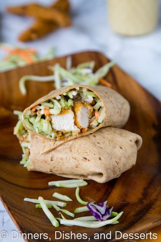 Honey Sesame Chicken Salad Wraps - Broccoli slaw coated in a creamy honey sesame dressing. Wrapped with crispy chicken for a quick and easy meal.