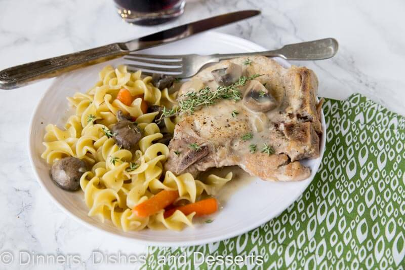 slow cooker pork chops on a plate with other food