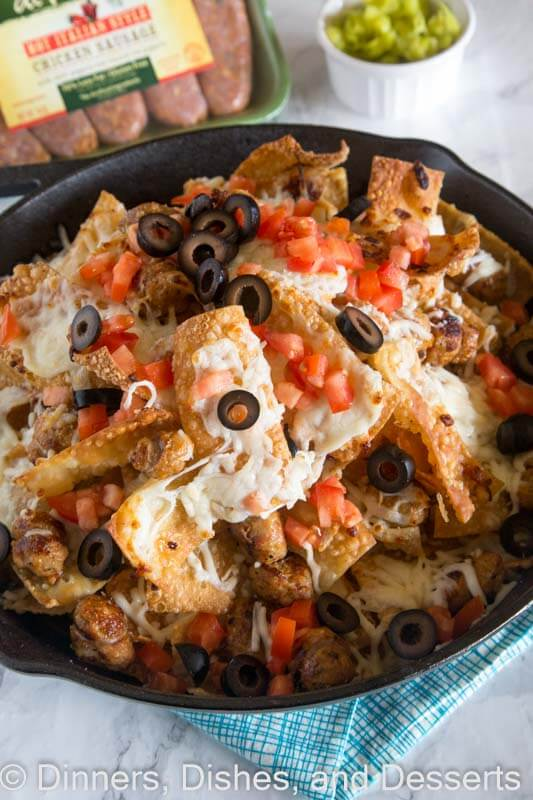 Italian Nachos with Sausage - Crispy wonton chips topped with plenty of cheese and Italian chicken sausage. Great appetizer for game day or any party!