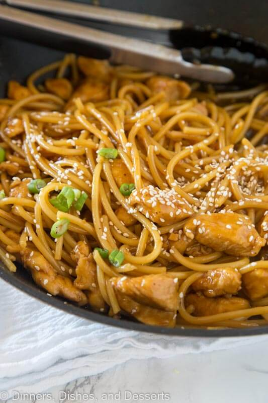 A dish is filled with food, with Noodle and Chow mein