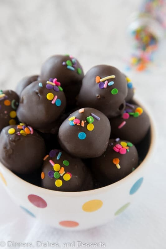 Nutella Oreo Truffles - classic Oreo truffles made even better by adding Nutella! Dipped in chocolate or rolled in sprinkles for an easy chocolate treat.