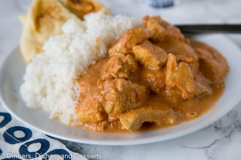A plate of food, with Butter chicken and Curry
