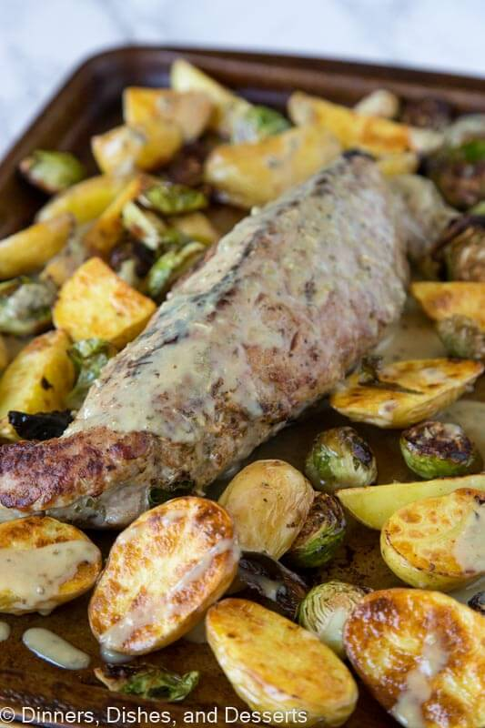 Sheet Pan Pork Tenderloin - tender and juicy pork tenderloin with Brussels sprouts, roasted potatoes and topped with a Dijon herb vinaigrette. Ready quickly, super easy, and so good!