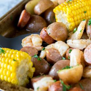Sheet Pan Shrimp Boil - an easy homemade version of a classic shrimp boil, made in the oven. Shrimp, sausage, potatoes, and corn make for one amazing meal!