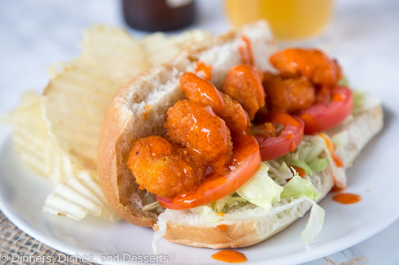 A plate of food, with Po\' boy and Ranch dressing