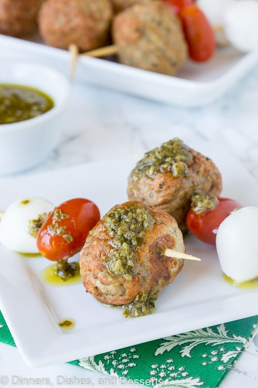 Italian Meatball Caprese Skewers - Make summer entertaining easy with these little skewers. An Italian style meatball, fresh Mozzarella cheese, and tomato, topped with a basil vinaigrette!