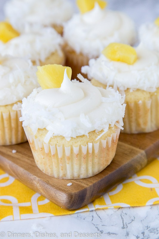 Pineapple Coconut Cupcakes - A moist and tender homemade cupcake that tastes like the tropics! Pineapple and coconut flavor the cupcakes and the frosting!