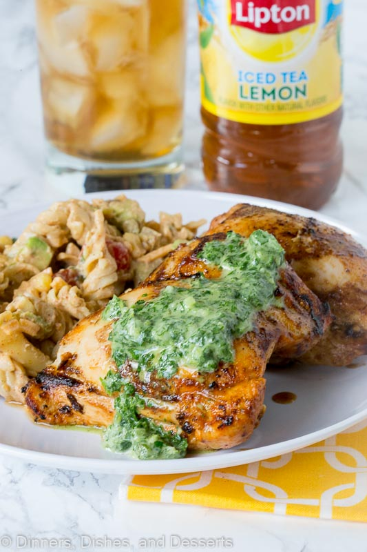 Grilled Chicken Thighs with Chile Herb Sauce - chicken thighs marinated in a blend of garlic, spices and lime juice. Grilled and then topped with a creamy herb and jalapeno sauce.